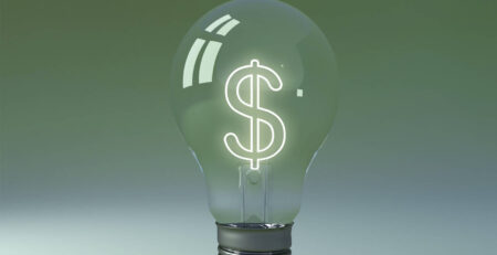 A light bulb with a dollar sign filament to show saving on an energy bill